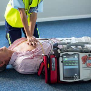 Paramedic using an external defibrillator during cardiopulmonary resuscitation